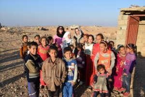 Some of the kids and COOPI Staff in the village