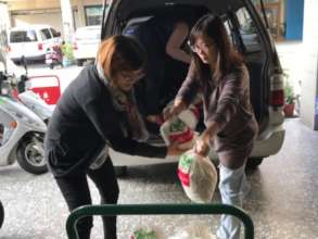 MSM staff moving donation from the donor's van