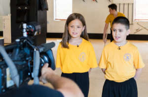 Children athletes being interview for CBC feature