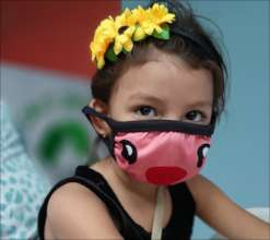 Family and friennds wear masks for open house