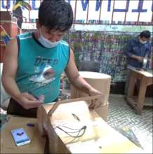young men work on art projects using masks