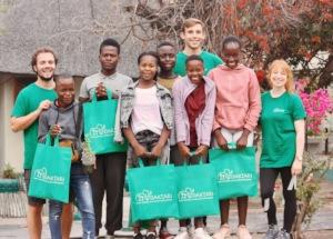 Picture of children and volunteers.