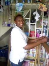 A happy woman in her beauty shop
