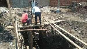 Erecting foundation pillar.