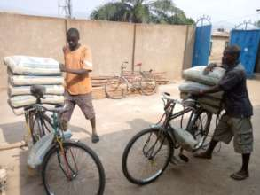 Bicycle taxis bringing cement to the building site