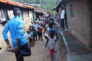 Eddy coaching other children in Kibera Slums