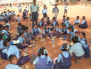 A school in Hubli - Children enjoying a a hot meal