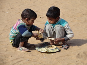 Younger siblings tag along to school for a meal