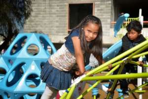 Member playing on new playground