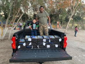 A father and son receiving a shipment of supplies