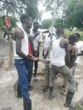 Drilling team repairing borehole