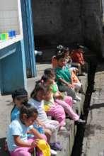 Partners teach kids to wash hands & brush teeth