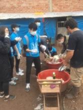 Student group washing feeding bowls
