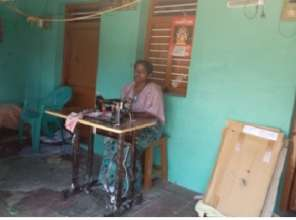 Deaf and dumb woman helped with sewing machine