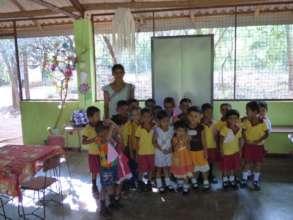 Sujeewa Lakmini and students at Pubudu Pre-School.