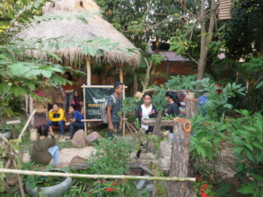 Students relax in the orchid garden