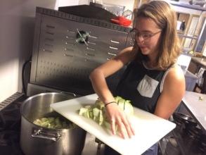 Hannah making fresh soup for a group dinner
