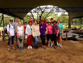 Red Hat Society members visit with Dr. Mayo