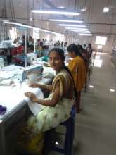 Suma beside a tailoring machine
