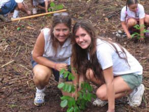 Co-founders, Janine and Jen planting a tree