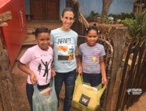Children receiving books & educational materials