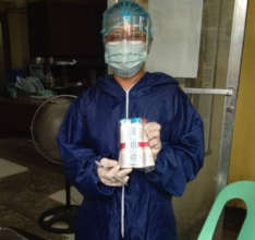 A health worker with Vitamin Angels supplies