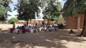 Community meeting at Mbando Village