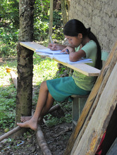Francis, one of our young readers, doing homework