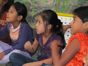 Girls listening to story hour.