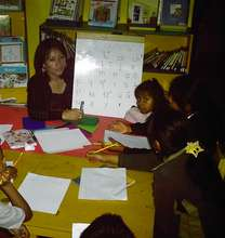 Girls learning to read and write in Maya language