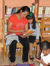 Mother and daughter reading in Chiche