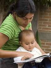Mom Reading With Baby