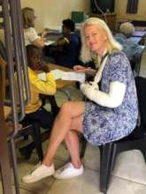 Bodil, an Edu Fun volunteer assessing a learner