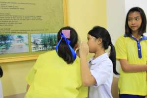 Younger and older student working together