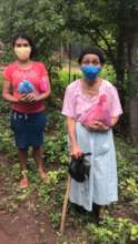 Patients with masks and hygiene kits