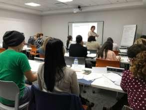 CPA Agnes Suarez offering a workshop to nonprofits