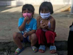 Receiving their mask providing safety and freedom