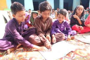 Farhan teaching Naveed and Usman
