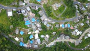 Blue tarps show La Marana the work still needed