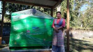 The school headmistress with the new generator.