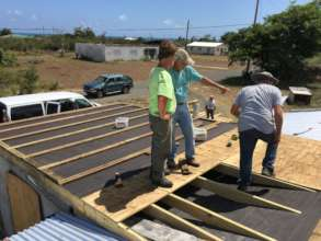 Volunteers construct a roof - and give hope & joy