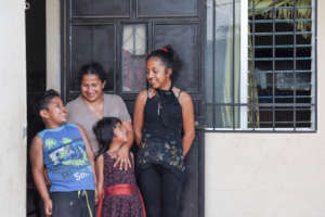 Lilian with her children and new Habitat home