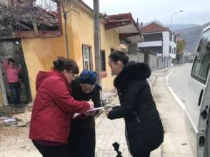 Delivering an aid package in Pogradec