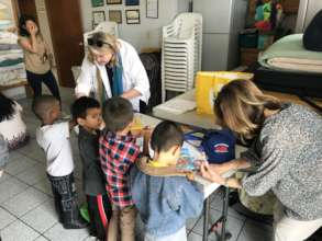 Donors visiting children at Madre Assunta shelter
