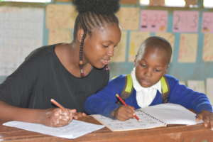 Tutor working with student