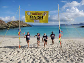 """Volunteers helping at the """"Beach to Beach"""" race"""