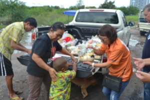 A boy and his mum receiving a food package.