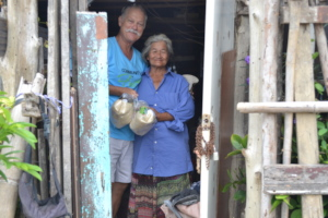 Visiting the elderly with food packages.