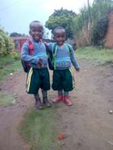 Twins in our program on their way to school