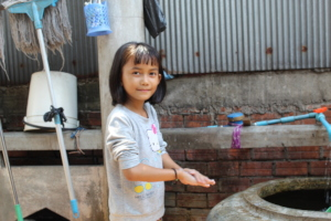 Kunthea* washing her hands to prevent Covid-19
